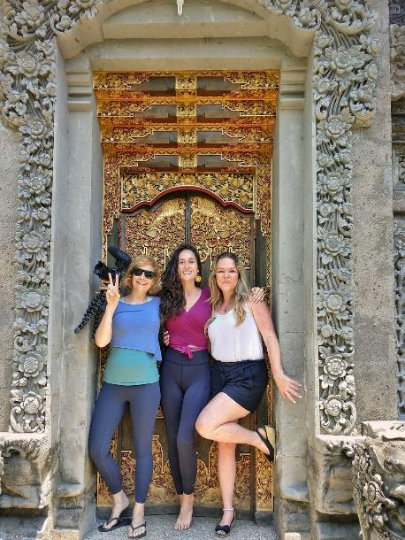 top travel blogger and influencer posing in front of a bali door
